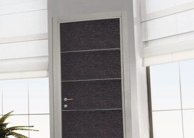 Porta tamburata Mod. CS.AL essenza rovere inserti e stipite alluminio